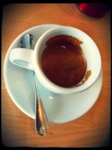 Peregrine dble espresso in a demitasse cup