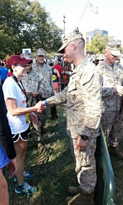 A finisher receives her medal
