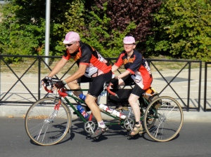 Tandem trike and matching pink caps.