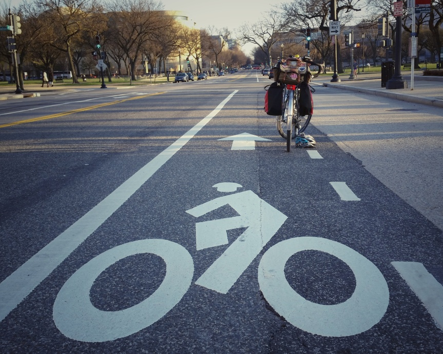 Quickbeam helmet kickstand bike lane